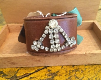 Leather cuff bracelet,recycled brown leather belt with vintage  rhinestone brooch and green dyed silk ribbon