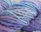 Hand spun yarn skein purple with silver thread; color Twilight Sparkle