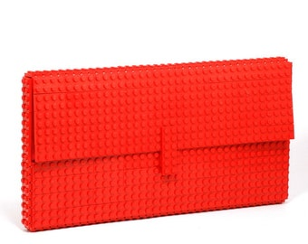 Red oversize clutch made entirely of LEGO bricks