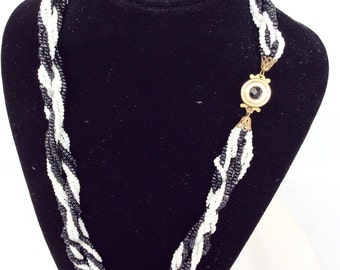 Beautiful glass torsade necklace black and white textured beads retro true vintage