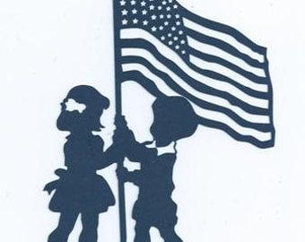 Children raising the flag silhouette