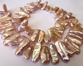 57 Beautiful Natural Light Mauve Pink Biwa Stick Fresh Water Pearls in Size 13.5 to 20mm long