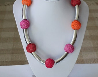 Festive necklace with silver plated tube beads and pink-orange polymer clay beads