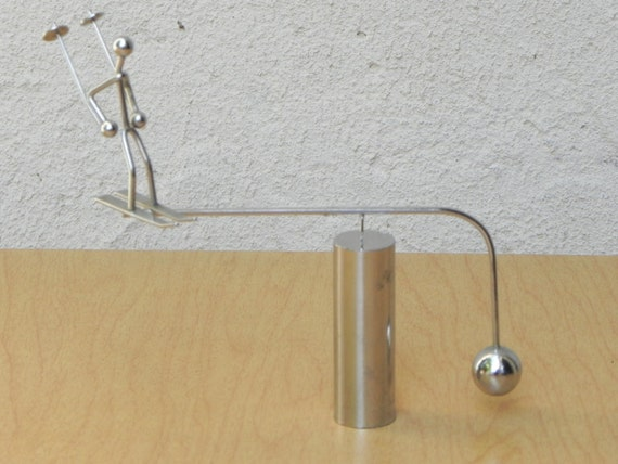 Skier chrome kinetic perpetual motion balance desk by for Kinetic desk sculpture