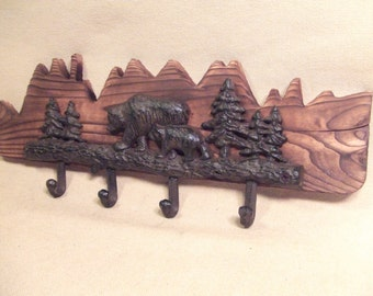 Rustic bear and mountian coat rack  -- lodge cabin decor -- rich patina on cast iron hooks and western cedar
