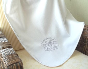 White fleece blanket with machine embroidery