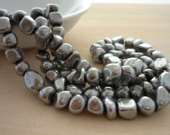 Silver coated pyrite nugget beads 4-6mm 1/2 strand