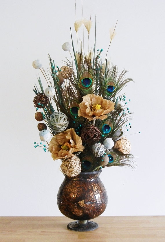 Earthy peacock feather floral arrangement in brown by