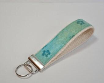 Key fob Key chain fabric wristlet - Tiny flowers on turquoise with gold flecks