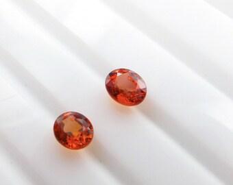SAPPHIRE. Orange. Songea Sapphire. Native Cut. Oval. 2  pc. 0.74 cts. 3.5x4.5 / 3.5x4 mm  (S1560)