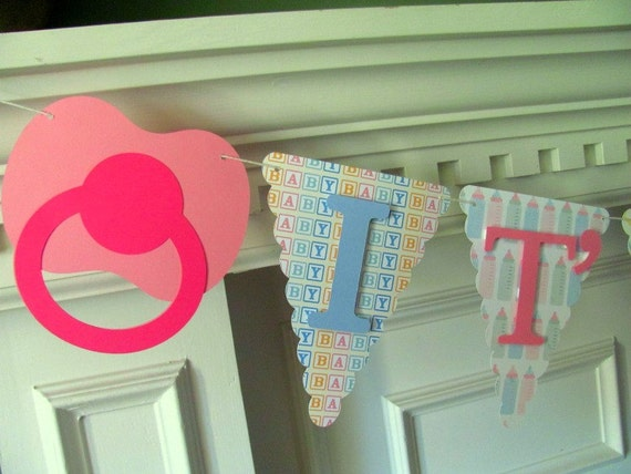 Gender Reveal Banner- It's A ?, Pink and Blue Pacifiers with Reveal Envelope