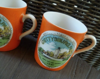2 Gettysburg Souvenir Cups. Eternal Light Peace Memorial. Vintage 1960s. Gettysburg, PA. Orange Green. Made in Japan.