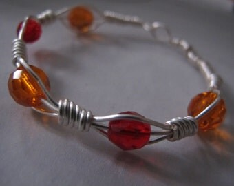 Silver wire wrapped bangle bracelet with orange and red crystals, can be made in any size, wire wrapped jewellery