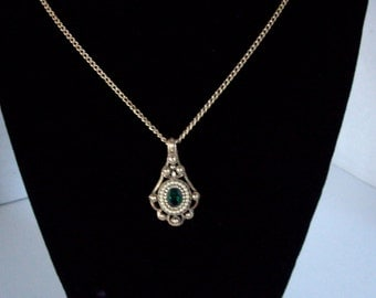Vintage Avon Gold Tone Pendent with faux emerald stone 1980s