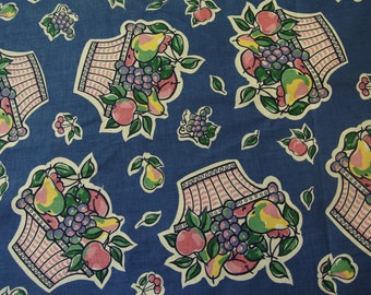Vintage 1980s fabric in highquality unused cotton with large multicolor fruit basket motive pattern on blue bottomcolor