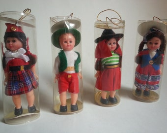 4 vintage folk dolls | international ornament dolls | vintage doll ornaments | vintage dolls in plastic tubes | small international dolls