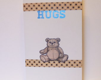 Greeting card or gift card with a brown Teddy Bear saying HUGS in metallic blue ink, Birthday card, Special occasion