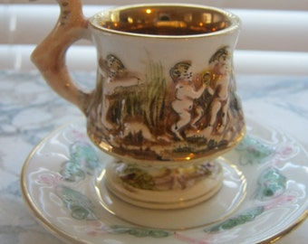 "Vintage Capodiamonte Italian Porcelain Gold Gilded ""Dragon"" Cherub Demitasse Cup and Saucer"