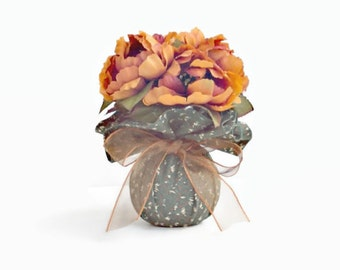 Floral Arrangement Small Tangerine Peonies In A Green Print Fabric Covered Vase Tied With Sheer Orange Green Ribbon