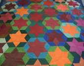 Quilt/coverlet: Vibrant six pointed solid color stars embroidered date Feb 1, 1945