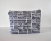 Padded woman's make up bag cosmetics pouch Modern abstract triangle tiny mountain zig zag chevron print in two tone grey in large.*