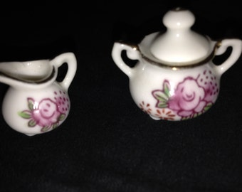 Porcelain dollhouse miniature handpainted sugar bowl with lid and creamer with gilt detail
