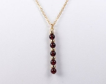 Garnet and Gold Bloodline Pendant Necklace