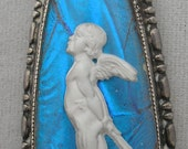 Butterfly Wings Cameo  - white cupid angel on an entrancing butterfly wing  blue  background