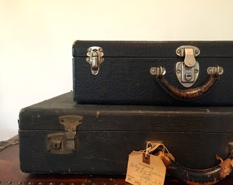 Vintage suitcase stack of two / old suitcases