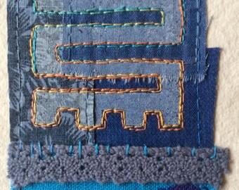 "Mini textile art: ""Initiative, Dynamism, Versatility"""