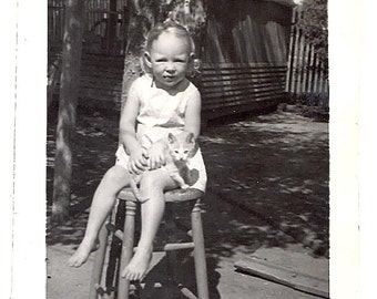 Barefoot GIRL w sweet KITTEN Cat sits on Wood Stool squinting n SUN Vintage Photo black and white snapshot