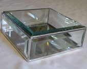 A clear beveled glass display box 6 x 6 x 2 inches for your treasures