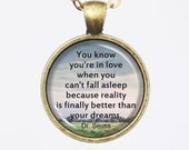 Love Quote Necklace, Dr. Seuss -You know you're in love when you can't fall asleep because reality is finally better than your dreams.