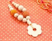 Simple nursing floral pendant necklace. Orange flower necklace