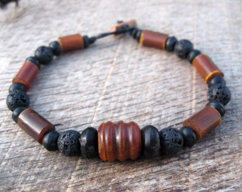 Mens surfer bracelet, horn and lava stone beads, handmade from earthy natural materials, on strong cord with toggle and loop clasp, tribal