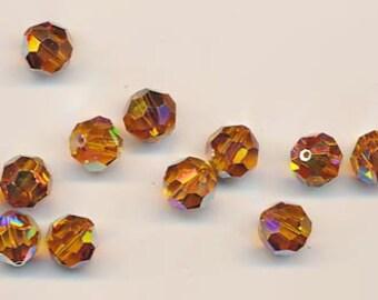 Twelve Swarovski crystals - Art. 5000 - 10 mm - topaz AB 2X