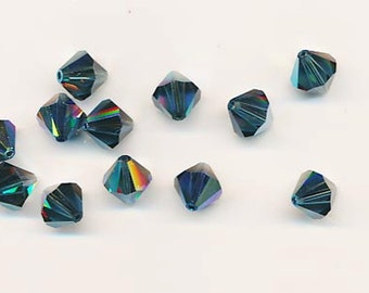 Twelve sparkling Swarovski crystals in the discontinued shape 5301: 10 mm - montana AB