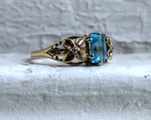 Vintage 9K Yellow Gold Blue Topaz and Diamond Ring.