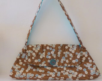 Handmade Amy Butler Madison purse in the colors of Brown,Teal and Gold.With embroidered pocket.