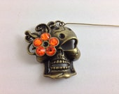 Flower skull orifice hook