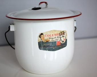 White vintage enamelware cook pot rimmed in red with lid and handle
