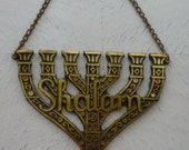 Judaica Vintage Shalom carved brass seven-arm Menorah wall hanging, made in Israel