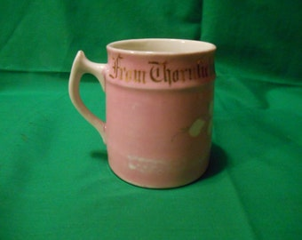 One (1), Pink Lustreware, Souvenitr Mug, from the Thornliebank Co-Operative Society, of Scotland, Circa 1920's.