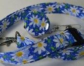Daisy on blue background ID lanyard, badge reel, stethoscope clip