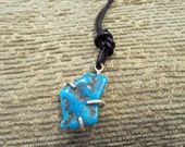 Turquoise Nugget Pendant, sterling prong set, leather cord