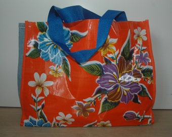 Orange and blue plastic flower bag