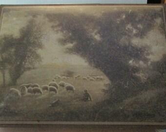 Antique Uneeda biscuit tin pastoral scene shepherd and his flock