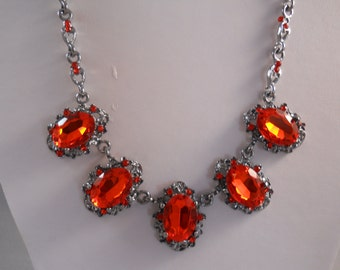Bib Necklace with Silver Tone, Red Crystal and Red Rhinestones Pendant on a Silver Tone Chain