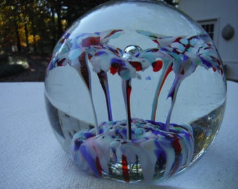 Paperweight with cranberry, blue, and white flowers