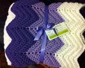 Purple, hand crocheted baby afghan. Generous size by GRANDMA D.